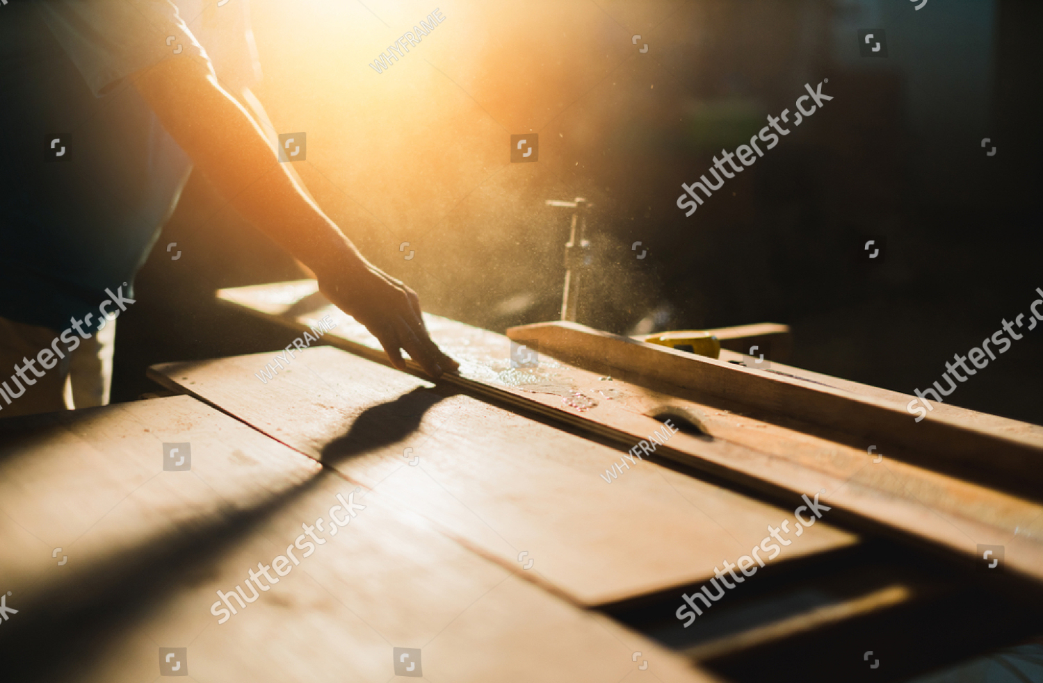 stock-photo-home-improvement-ideas-concept-with-carpenter-work-with-sawing-wood-machine-site-construction-1172886529 copy