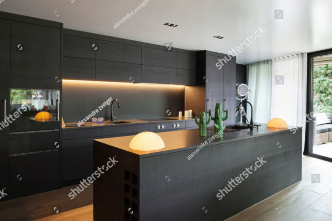 stock-photo-modern-kitchen-with-black-furniture-and-wooden-floor-448253599 copy