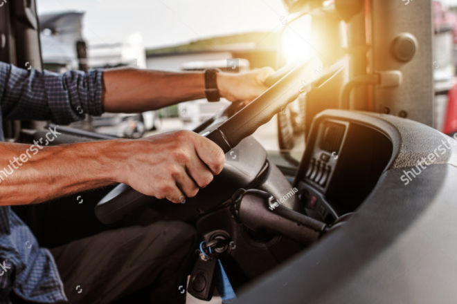 stock-photo-cdl-commercial-driver-inside-of-his-truck-transportation-industry-theme-1040943541copy