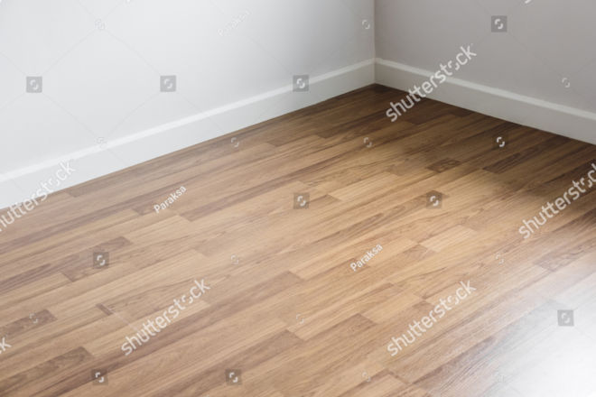 stock-photo-laminated-wood-floor-with-white-wall-room-s-corner-644662831 copy